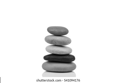 Stack of five pebble stones isolated on white background with soft shadow