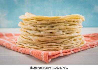 Stack of Flour Tortillas on Orange Napkin  Horizontal