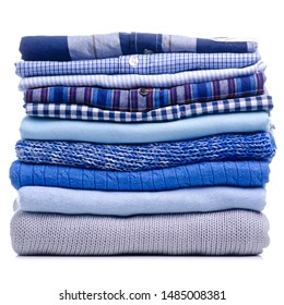 Stack folded blue shirt clothing on white background isolation