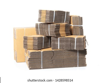 Stack of folded cardboard boxes tied with rope isolated on white