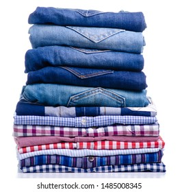 Stack folded casual shirt and jeans on white background isolation