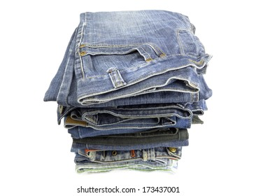 A stack of folded jeans on white background