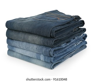 Stack of Folded Jeans in Various Shades of Denim