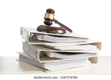 stack of folders and a judge gavel on a desk, isolated on a white background, concept for justice, business and finance, copy space, selected focus, narrow depth of field