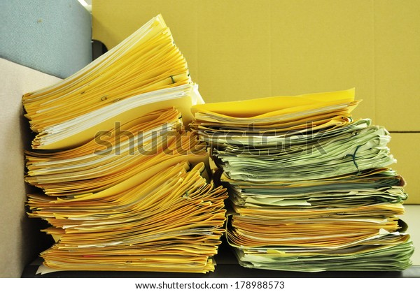 Stack Of Folders On The Table