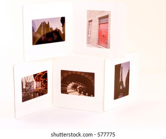 Stack of four 35mm slides showing travel scenes of Europe.