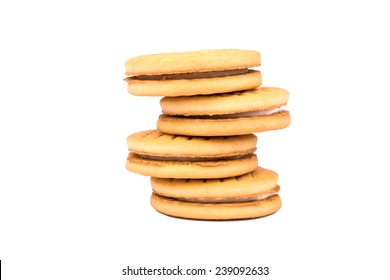 A stack of four cookies with cream on a white background