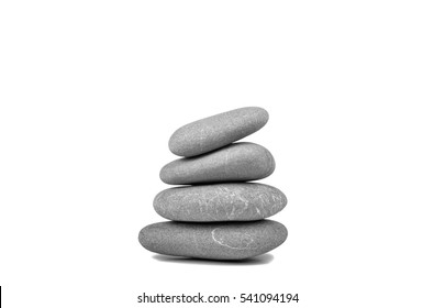 Stack of four pebble stones isolated on white background with soft shadow