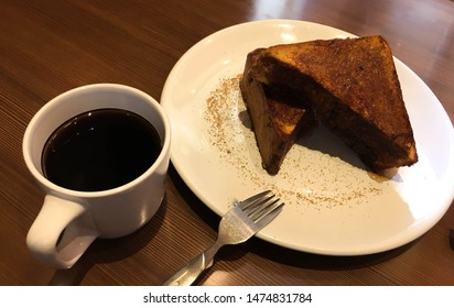 Stack of french toast and coffee