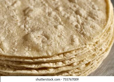 A stack of fresh corn tortillas