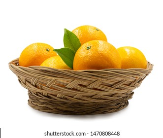 Stack of fresh orange fruit in basket on white background.with clipping path.