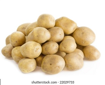 Stack of fresh potatoes on bright background