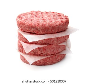Stack of fresh raw burger patty isolated on white