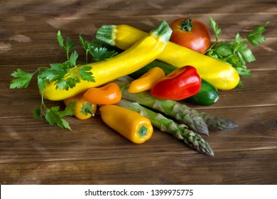 Stack of Fresh summer vegetables on brown wood background