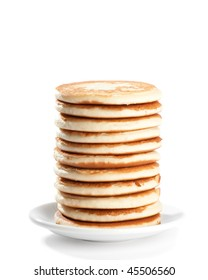 Stack of freshly prepared pancakes on white background