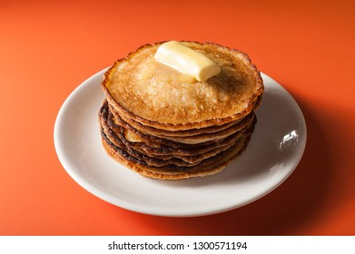 a stack of fried pancakes on plate
