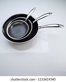 stack of the frying pan on the white background