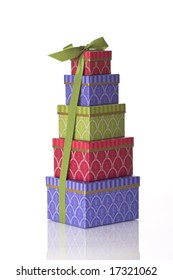 Stack of gift boxes tied together with a green ribbon