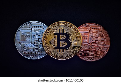 Stack of glod bitcoins with a single coin facing the camera in B sharp focus, Cryptocurrency concept. Virtual currency digital payment system