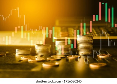 Stack of gold money coin with trading graph, financial investment concept can be use as background