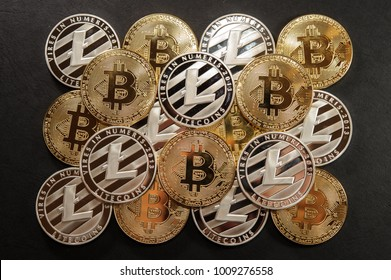 Stack of golden bitcoin and silver litecoin coins