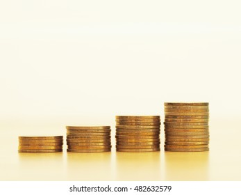 Stack of golden coins growing up. Growth business and financial concept.