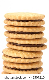 Stack of golden shortbread butter  biscuits filled with chocolate cacao filling