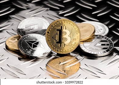 stack of  golden silver crypto currency coin on metal diamond steel plate financial black background bitcoin ethereum litecoin monero dash iota ripple