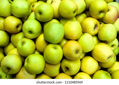 Stack of green apples at a greengrocer
