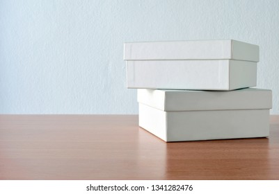 Stack of green boxes on the desk against green background.