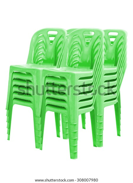 Stack of green plastic chairs on white