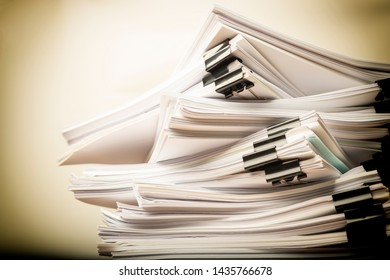 Stack of grunge document paper with colorful paperclip with copy space, business concept paperless used and work overload.