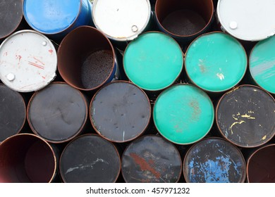 stack of grunge rusty oil barrels as background.