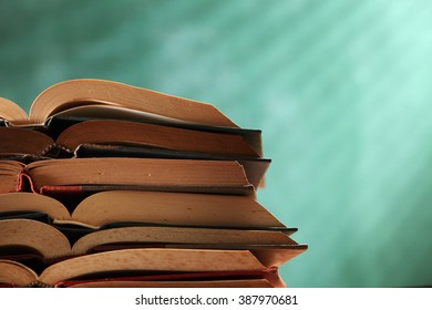 stack of hardcover book in front of blackboard
