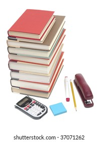 Stack of hardcover books with office supplies