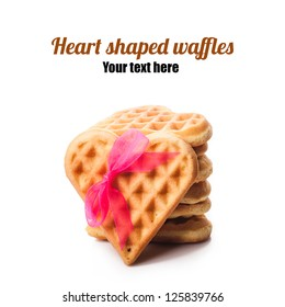Stack of heart shaped waffles isolated on white background
