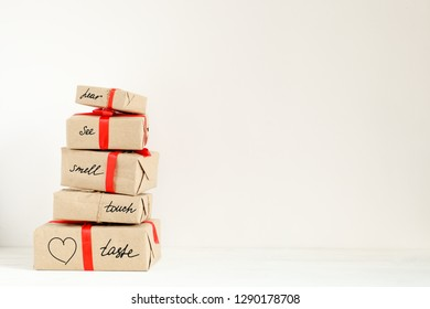 Stack of holiday boxes with suprise on valentine day. Concept of romantic adventure on holiday with copy space