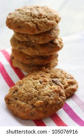 A stack of Homemade chocolate, nut and oat cookies