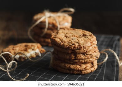 Stack of homemade cookies on black stripped napkin