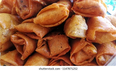 A stack of homemade deep fried pork and vegetable spring rolls background, Bangkok Thailand