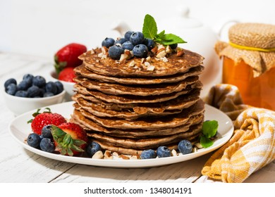 stack of homemade delicious pancakes for breakfast on white table, closeup horizontal