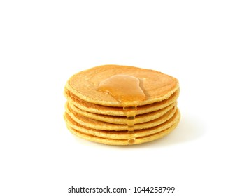 Stack of homemade flourless oatmeal pancakes with honey isolated on white background