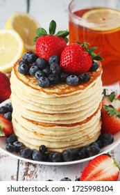 A stack if home-made pancakes with berry