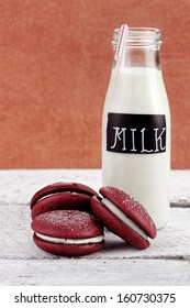 Stack of homemade Red Velvet Whoopie Pies or Moon Pies made with cream cheese frosting.