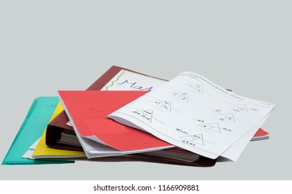 stack of homework, mathematics task, books, file, booklet and white background
