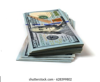 Stack of hundred dollar bills on white background