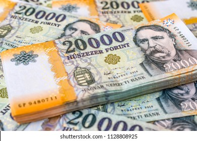 Stack of Hungarian money (forints) laying on 20000 forint banknotes
