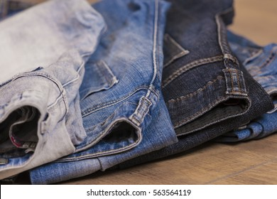stack of jeans clothes