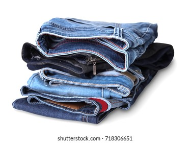 Stack jeans isolated on white.