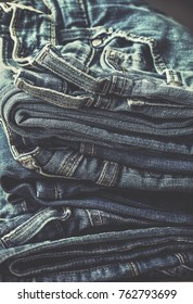 stack of jeans in vintage style. toning